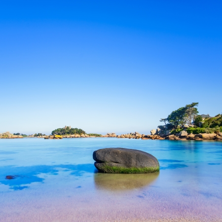 ploumanach: Ploumanach, ock and bay beach in morning  Pink granite coast, Perros Guirec, Brittany, France  Long exposure  Stock Photo
