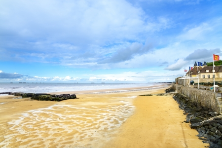 allies: Arromanches les Bains, seafront beach and remains of the artificial harbour, used on D-Day in World War II  Normandy, France  Stock Photo