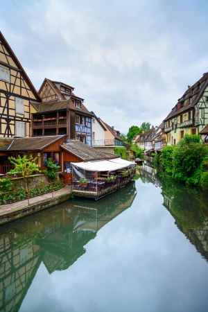 Colmar, Petit Venice, water canal and traditional colorful houses  Alsace, France