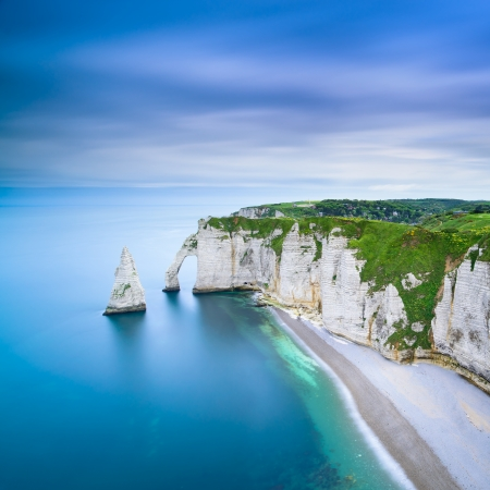 Etretat Aval cliff, rocks and natural arch landmark and blue ocean  Aerial view  Normandy, France, Europe  Stock Photo