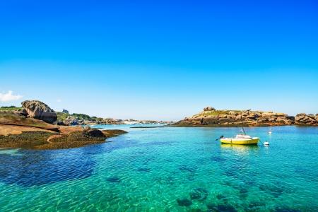 Tregastel, boat in fishing port in pink granite coast and atlantic ocean  Armor coast les rochers, Brittany, France  Europe