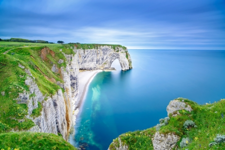 rock arch: Etretat, la Manneporte natural rock arch wonder, cliff and beach  Long exposure photography  Normandy, France  Stock Photo