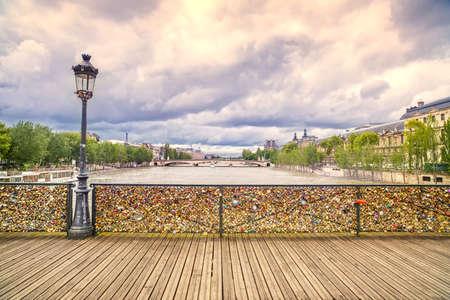 streetlamp: Love padlocks on Pont des Arts bridge, Seine river in Paris  France, Europe  Stock Photo