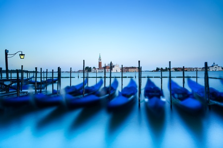 venice italy: Venice, gondolas or gondole on a blue sunset twilight and San Giorgio Maggiore church landmark on background  Italy, Europe