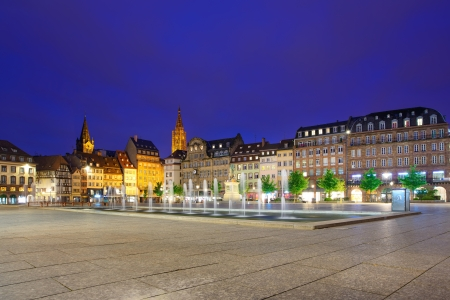 Strasbourg sunset in central Place Kleber square  Fountain in the middle and Cathedral on background  Alsace, France