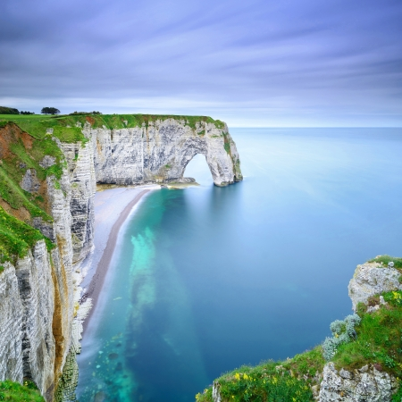 Etretat, la Manneporte natural rock arch wonder, cliff and beach  Long exposure photography  Normandy, France  photo