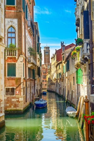 campanile: Venice cityscape, narrow water canal, campanile church on background and traditional buildings  Italy, Europe