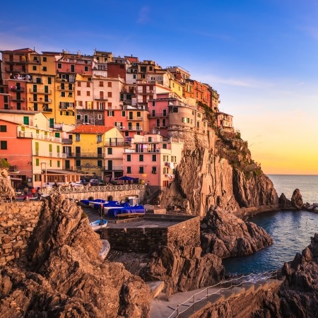 cinque: Manarola village on cliff rocks and sea at sunset , Seascape in Five lands, Cinque Terre National Park, Liguria Italy Europe  Long Exposure Photography