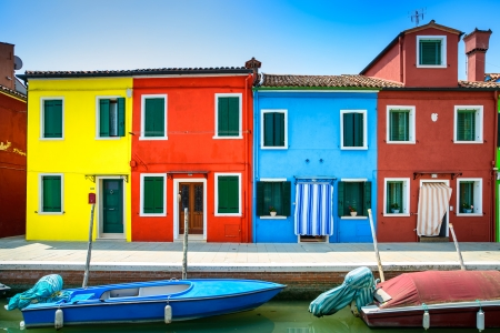 Venice landmark, Burano island canal, colorful houses and boats, Italy  Long exposure photography Imagens