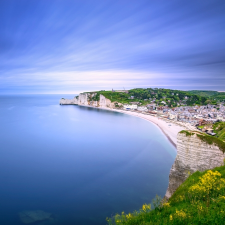 Etretat village and its bay beach, aerial view from cliff  Normandy, France, Europe  Long exposure photography Imagens