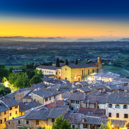 San Gimignano night aerial view, church and medieval town landmark  Tuscany, Italy, Europe  photo