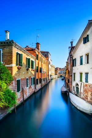 Venice cityscape, narrow water canal, bridge and traditional buildings  Italy, Europe  photo