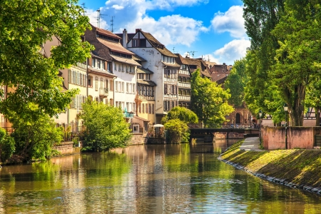 Strasbourg, water canal in Petite France area  Half timbered houses and trees in Grand Ile  Alsace, France