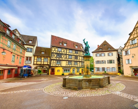 colmar: Colmar, Petit Venice, fountain, square and traditional half timbered colorful houses  Alsace, France