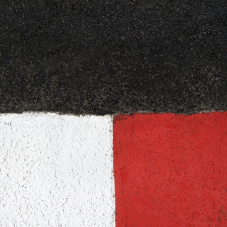 Texture of motor race asphalt and re white curb  Close up on Monaco Montecarlo Grand Prix street circuit photo