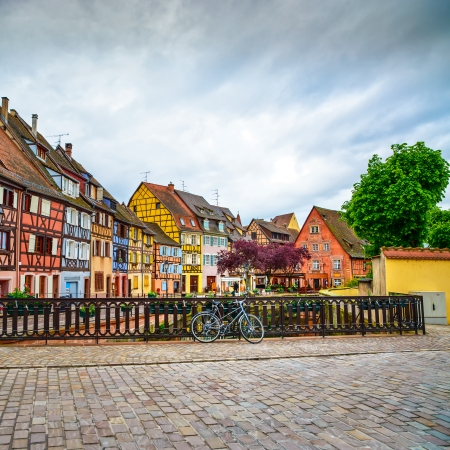 Colmar, Petit Venice, bridge on water canal, bike and traditional colorful houses  Alsace, France  Stock Photo