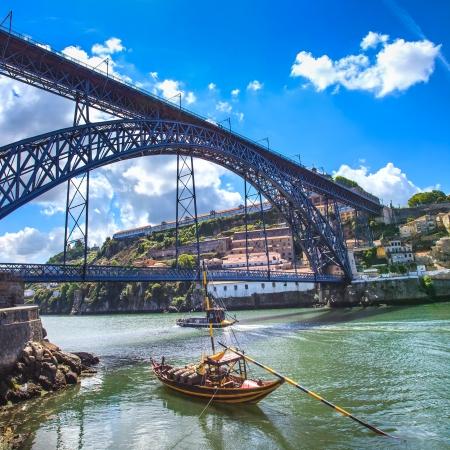 oporto: Oporto or Porto city skyline, Douro river, traditional boats and Dom Luis or Luiz iron bridge  Portugal, Europe