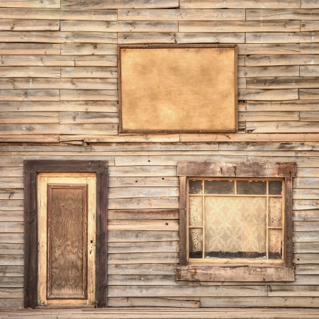 old building facade: Western vintage ranch wooden facade background or pattern  Door, window and blank or empty board