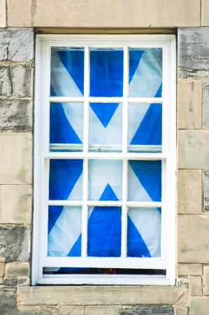 Scottish flag in a traditional white window  Scotland, Uk, Europe photo