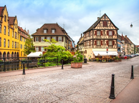 timbered: Colmar, Petit Venice, canal bridge and traditional half timbered colorful houses  Alsace, France  Stock Photo