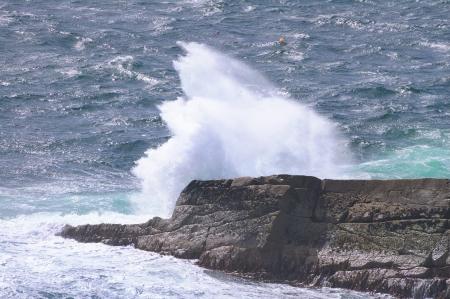 breaking wave: Ocean wave breaking on the rocks of the coastline  Scotland, Uk