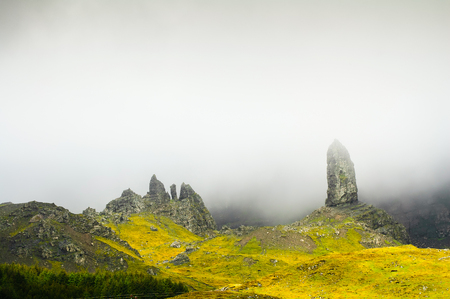 isle: The old man of Storr rock in the fog on Isle of Skye mountains  Scotland, Uk, Europe