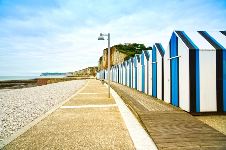 Yport and Fecamp, Normandy  Beach huts or cabins and cliffs in low tide ocean  France, Europe  photo