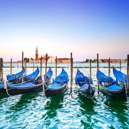 Venice sunset, gondolas or gondole on a blue sky and San Giorgio Maggiore church landmark on background  Italy, Europe  photo