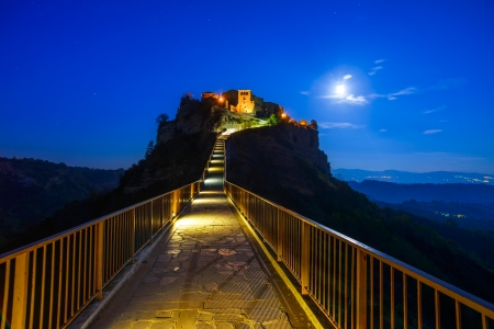 Civita di Bagnoregio ghost town landmark, bridge view on twilight  Lazio, Italy, Europe  photo