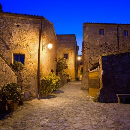 crepuscle: Civita di Bagnoregio ghost town landmark,  medieval village view on twilight  Lazio, Italy, Europe  Stock Photo