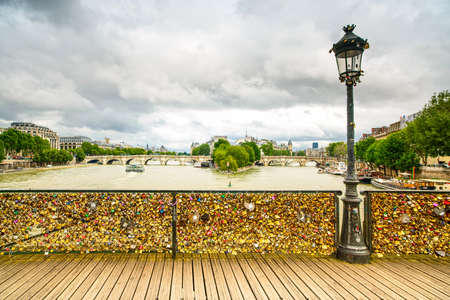 des: Love padlocks on Pont des Arts bridge, Pont Neuf and Seine river in Paris  France, Europe  Stock Photo