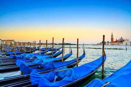 Venice, gondolas or gondole on a blue sunset twilight and San Giorgio Maggiore church landmark on Italy, Europe  photo