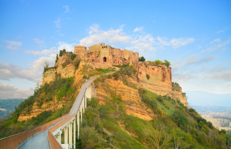 Civita di Bagnoregio ghost town landmark, bridge view on sunset  Lazio, Italy, Europe  photo
