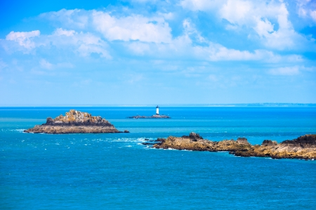 Landes island and lighthouse Point du Grouin in Cancale, France photo