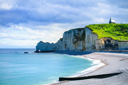 Etretat cliff and church landmark and its beach on morning in Normandy, France 스톡 콘텐츠