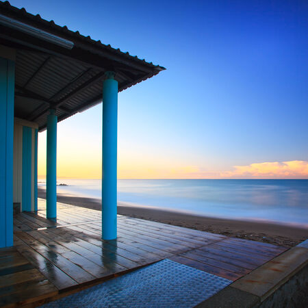 crepuscle: Beach bathhouse or bath house and colonnade architecture, sea on morning  Tuscany Italy  Long exposure photography