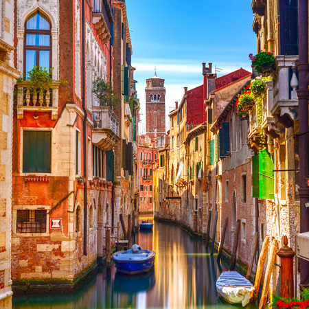 Venice cityscape, narrow water canal, campanile church on background and traditional buildings  Italy, Europe
