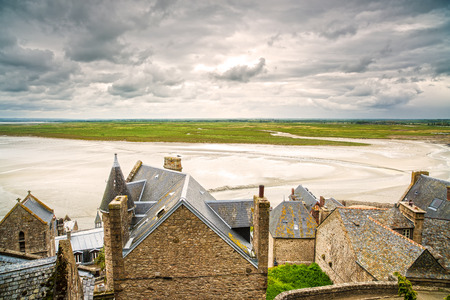 michel: Mont Saint Michel monastery landmark and bay in low tide and bad weather  Normandy, France, Europe Stock Photo