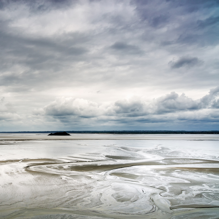 Low tide in Mont Saint Michel Bay landmark  Normandy, France, Europe photo