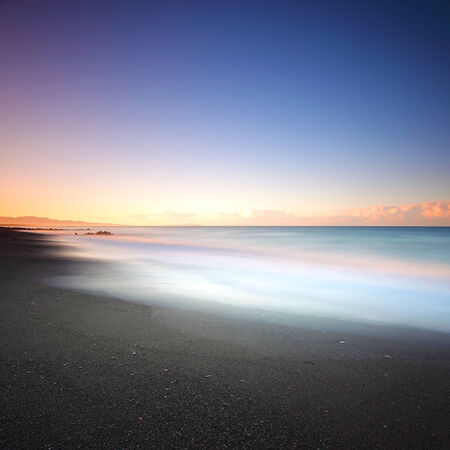 crepuscle: Beach dark sand and sea on morning  Tuscany Italy  Long exposure photography  Stock Photo