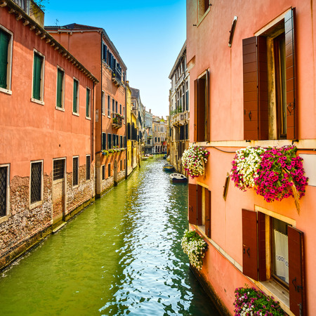 Venice cityscape, Cannaregio water canal, flowers, building and boats  Italy, Europe  photo