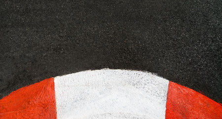 Texture of motor race asphalt and curved red white curb  Close up on Monaco Montecarlo Grand Prix street circuit photo