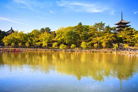 nara park: Park, pond reflection and Toji temple pagoda in Nara city  Japan, Asia  Editorial