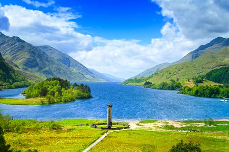 jacobite: Glenfinnan Monument and Loch Shiel lake spring landscape  Lochaber, Highlands of Scotland, United Kingdom, Europe