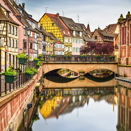 colmar: Colmar, Petit Venice, bridge, water canal and traditional colorful houses  Alsace, France  Long exposure  Stock Photo