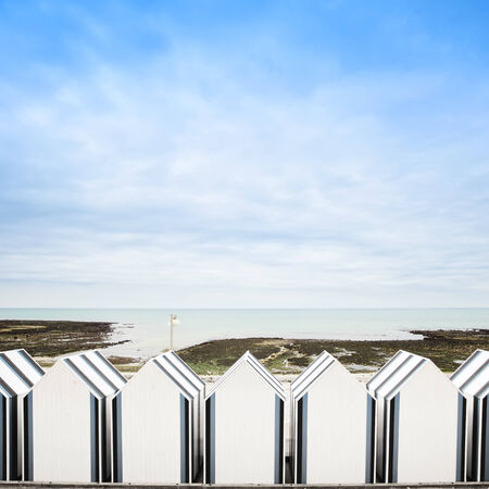 Yport, between Etretat and Fecamp, Normandy  Beach huts or cabins in low tide ocean  France, Europe  photo