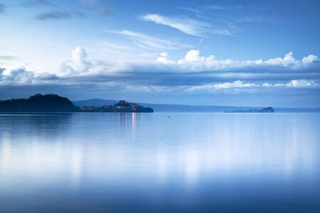 crepuscle: Capodimonte headland village in Bolsena lake on sunset, Italy