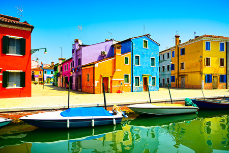 Venice landmark, Burano island canal, colorful houses and boats, Italy  Long exposure photography photo