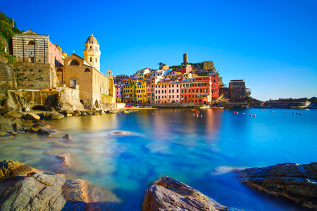 cinque: Vernazza village, curch, rocks and sea harbor on sunset, Seascape in Five lands, Cinque Terre National Park, Liguria Italy Europe  Long Exposure