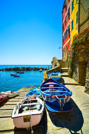 Riomaggiore village street, boats and sea in Five lands, Cinque Terre National Park, Liguria Italy Europe  photo